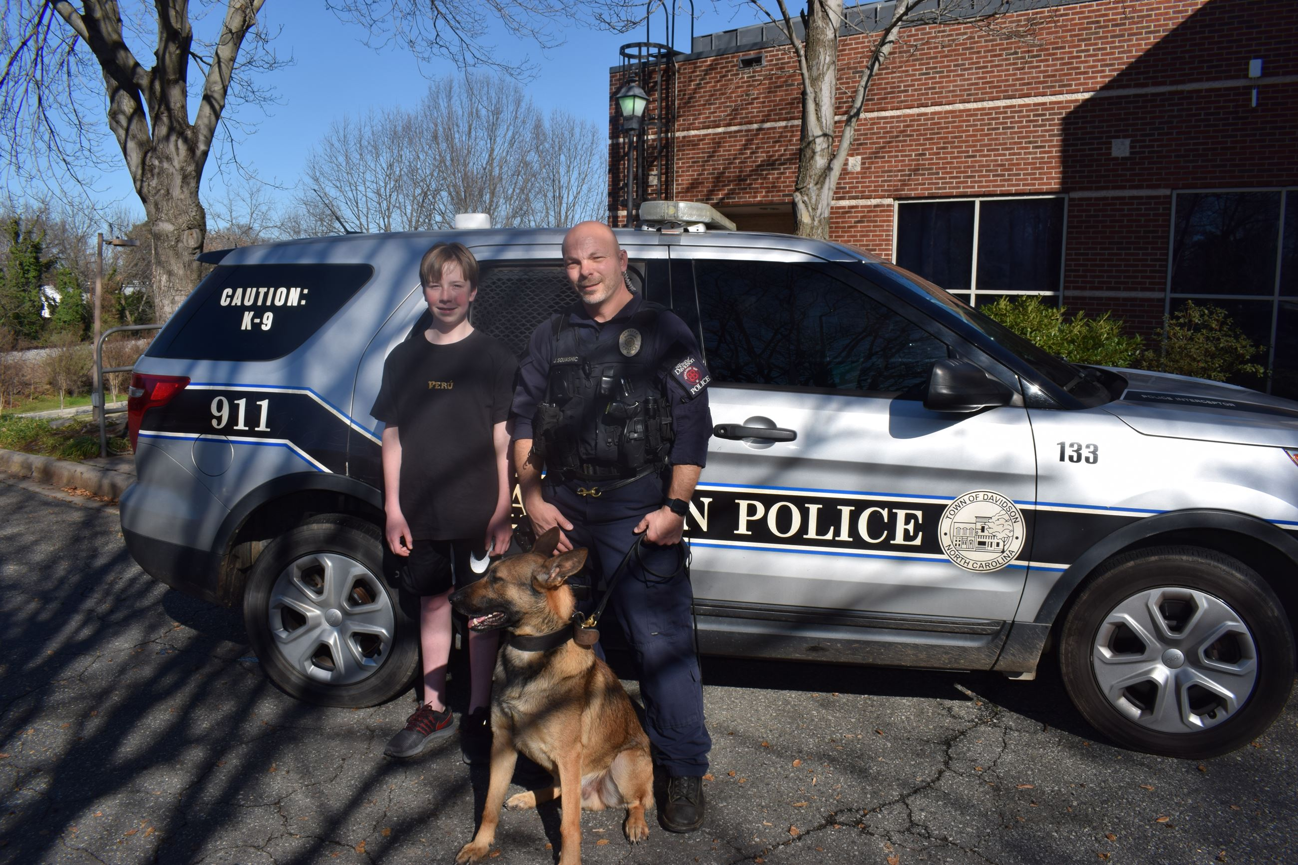 Corporal Joe Squashic, K-9 Bajouk, and resident Will Densmore